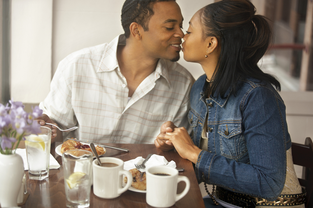 African American Couple kissing on a date