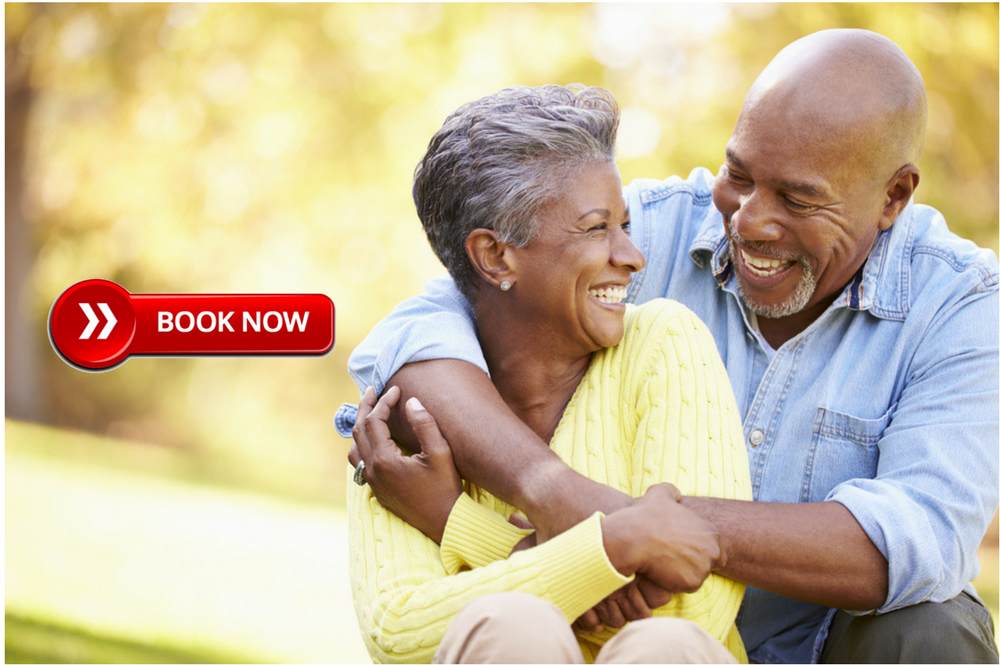 Senior African American Couple embracing and smiling